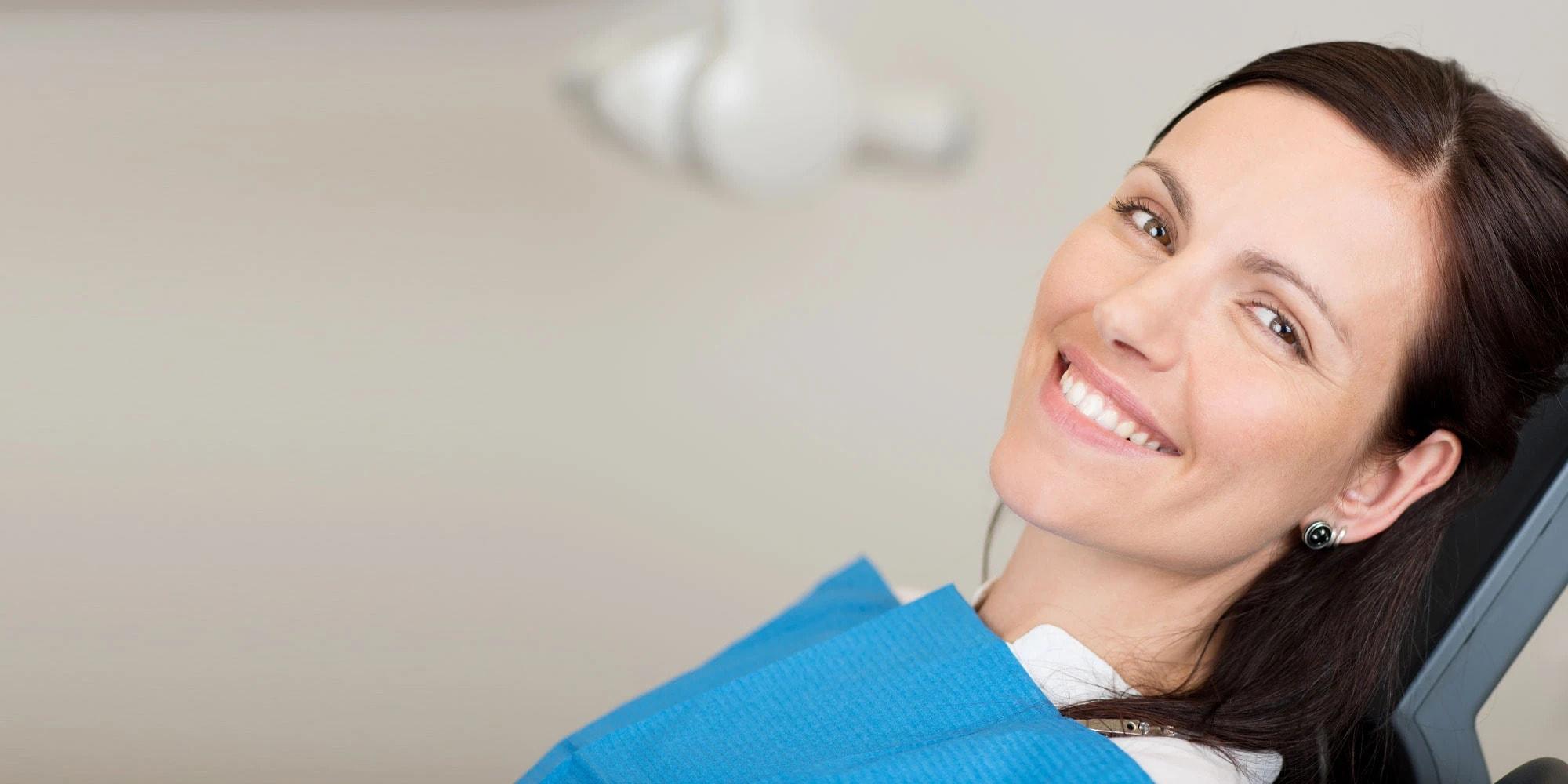 dental patient smiling after dental procedure