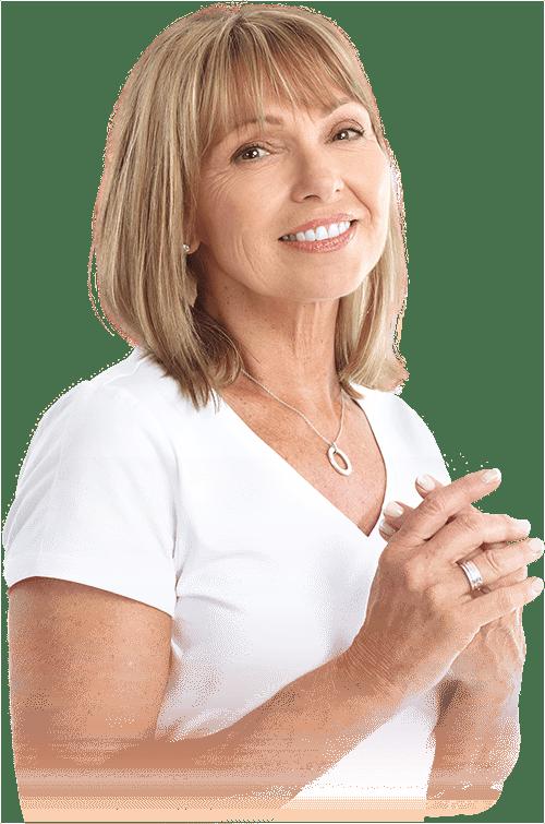 dental patient smiling after ridge augmentation procedure